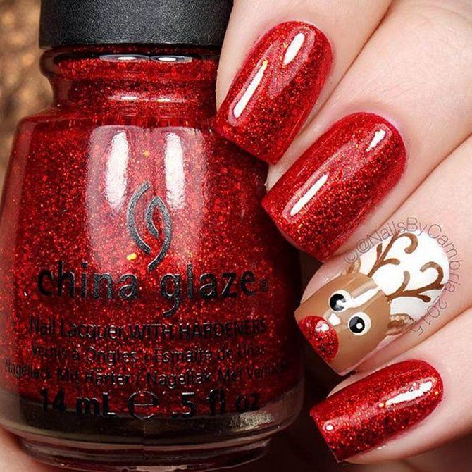 червоний новорічний манікюр з оленем