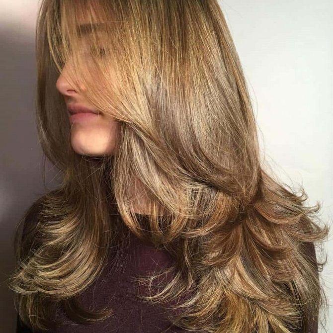 Жіноча стрижка на довге волосся 2020 року
