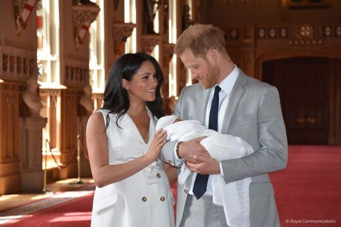Prince Harry and Meghan Markle with the son