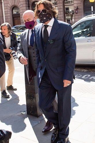Джонни Депп и Эмбер Херд впервые встретились в суде: нагадила в постели и был тираном (фото) 1